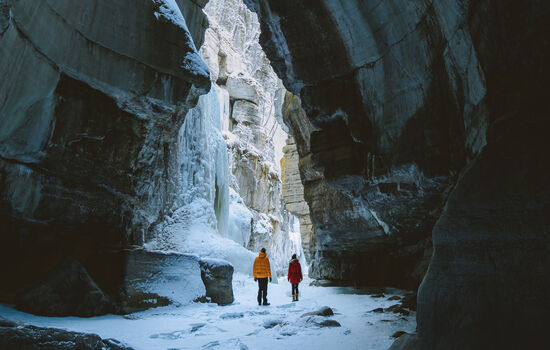 Discover glimmering walls of ice in frozen canyons