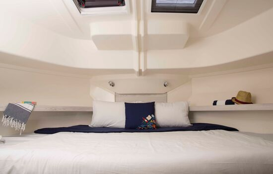 Comfortable bedding while sleeping onboard your private boat.