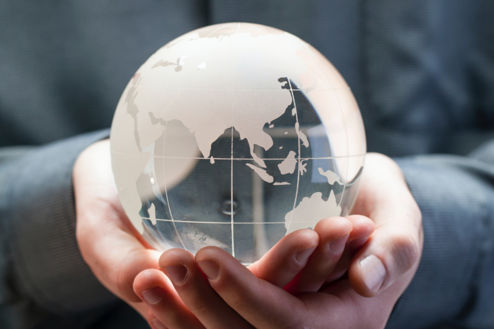 Sustainability, globe in hands
