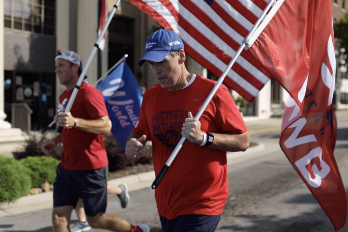 Men carrying flags in the 9-11 Moving Tribute