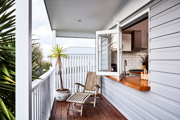 Deck with windows that open to kitchen