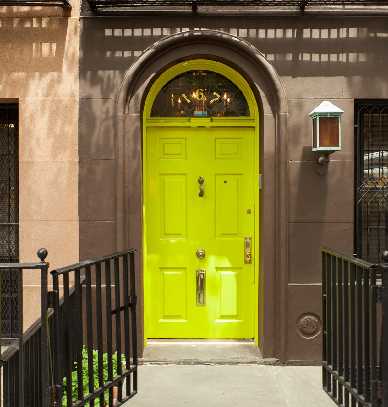 Lime door on a city apartment