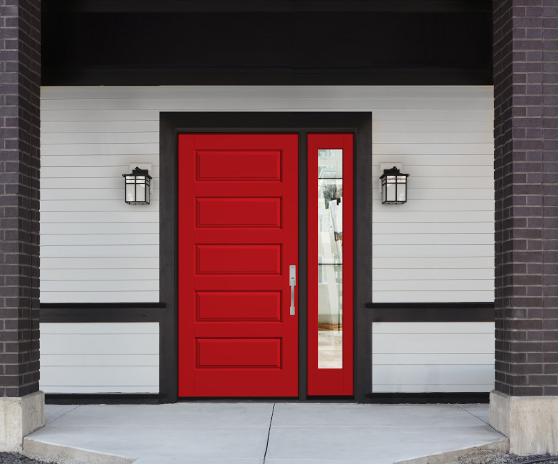 Bright red front door on a modern home