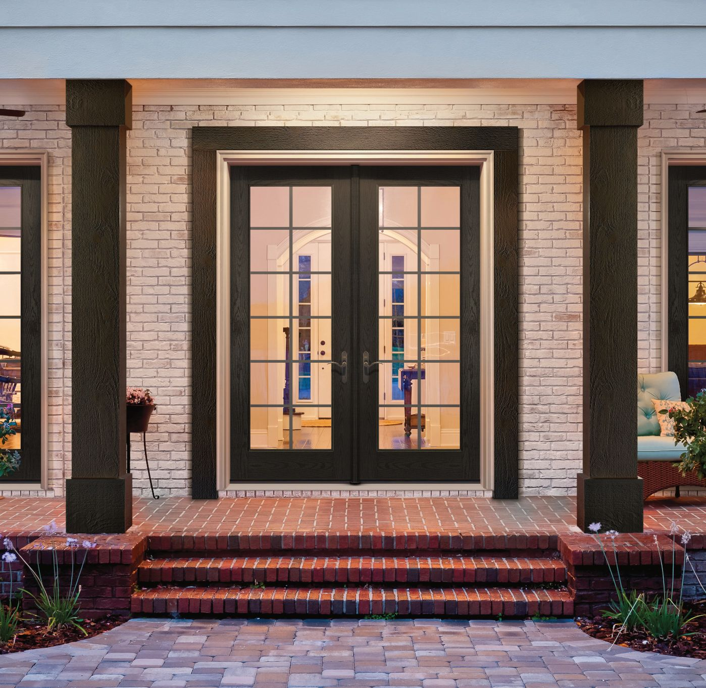 Dark stained entry door on a brick home