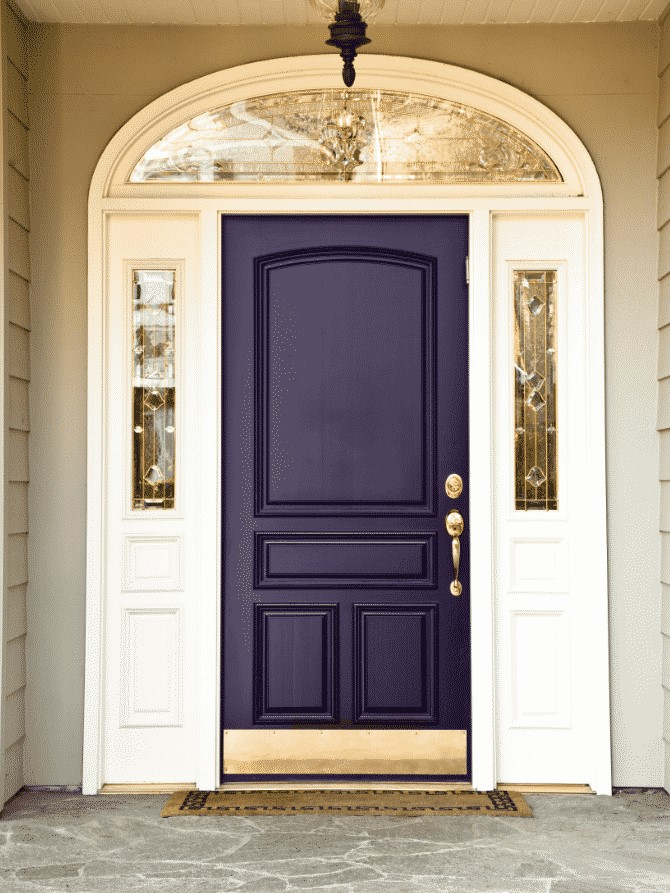 Purple front door on an ornate porch