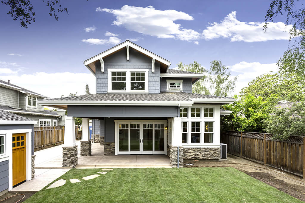 Back view of blue Craftsman home