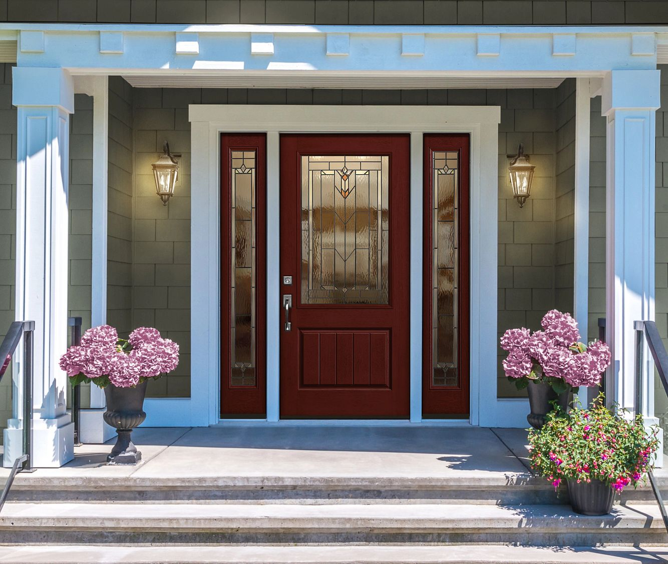Wine-colored front door on a home with green siding