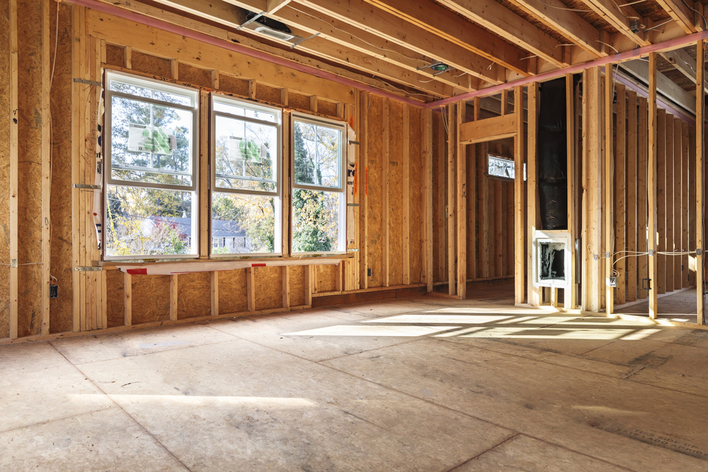 Bare construction of a room awaiting remodeling