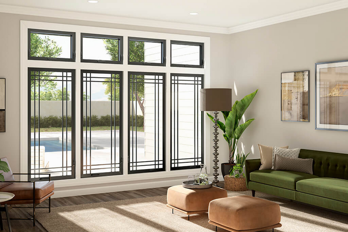Interior view of black frame windows in a living room with light colored walls