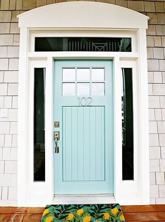 Light blue pastel entry door on a beige house