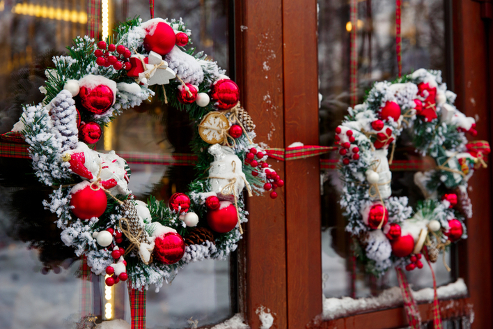 Christmas wreaths on a double front door
