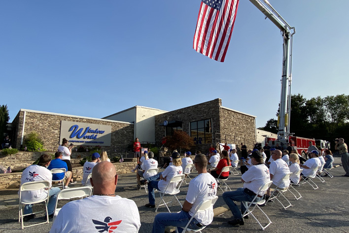 Employees gather for the 9-11 Moving Tribute at Window World, Inc.