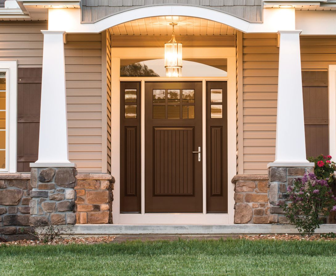 Chestnut-colored entry door on a beige house
