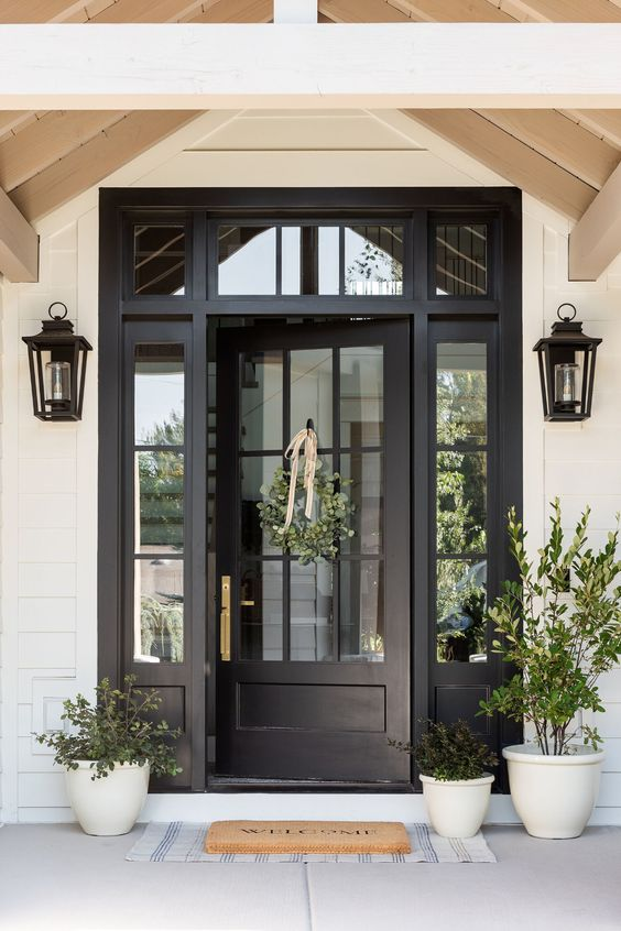 Black entry door with sidelites