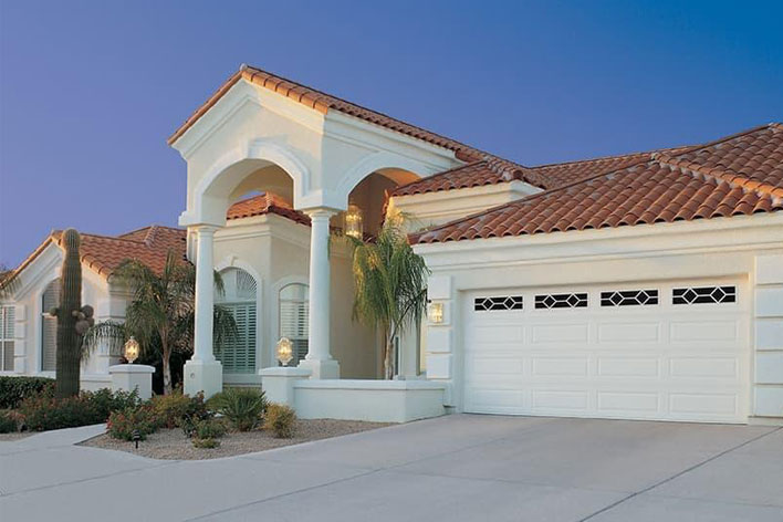White garage door on a Southwest style house