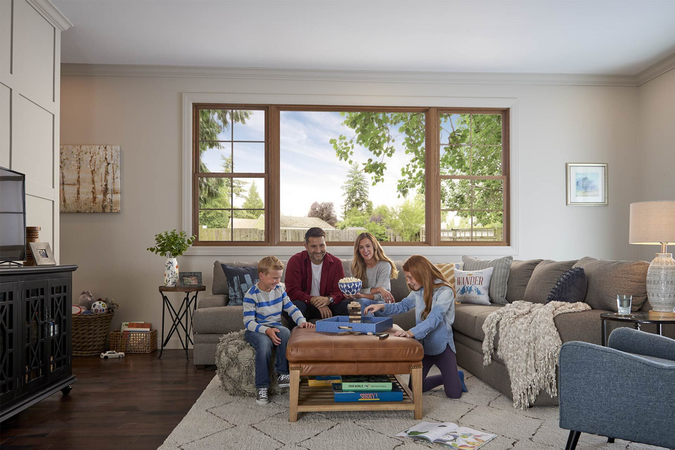 Family playing games together in living room