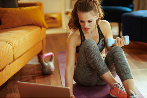 Woman exercising from home