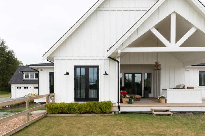Front view of a farmhouse-style home with a large front porch