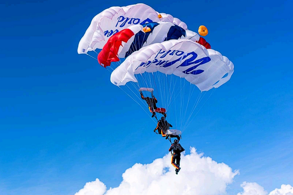 Soldiers parachuting with Window World parachutes