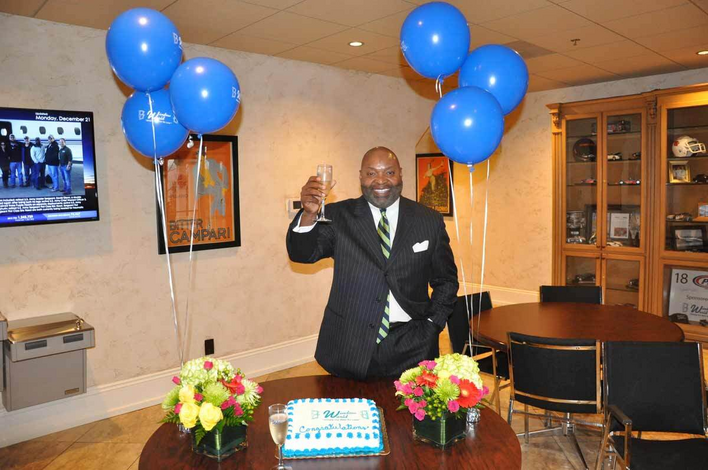 Window World franchisee Greg Deathridge toasts a new store from the corporate office