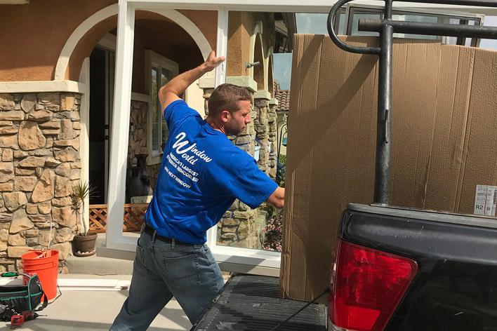 Window installer unloading a truck