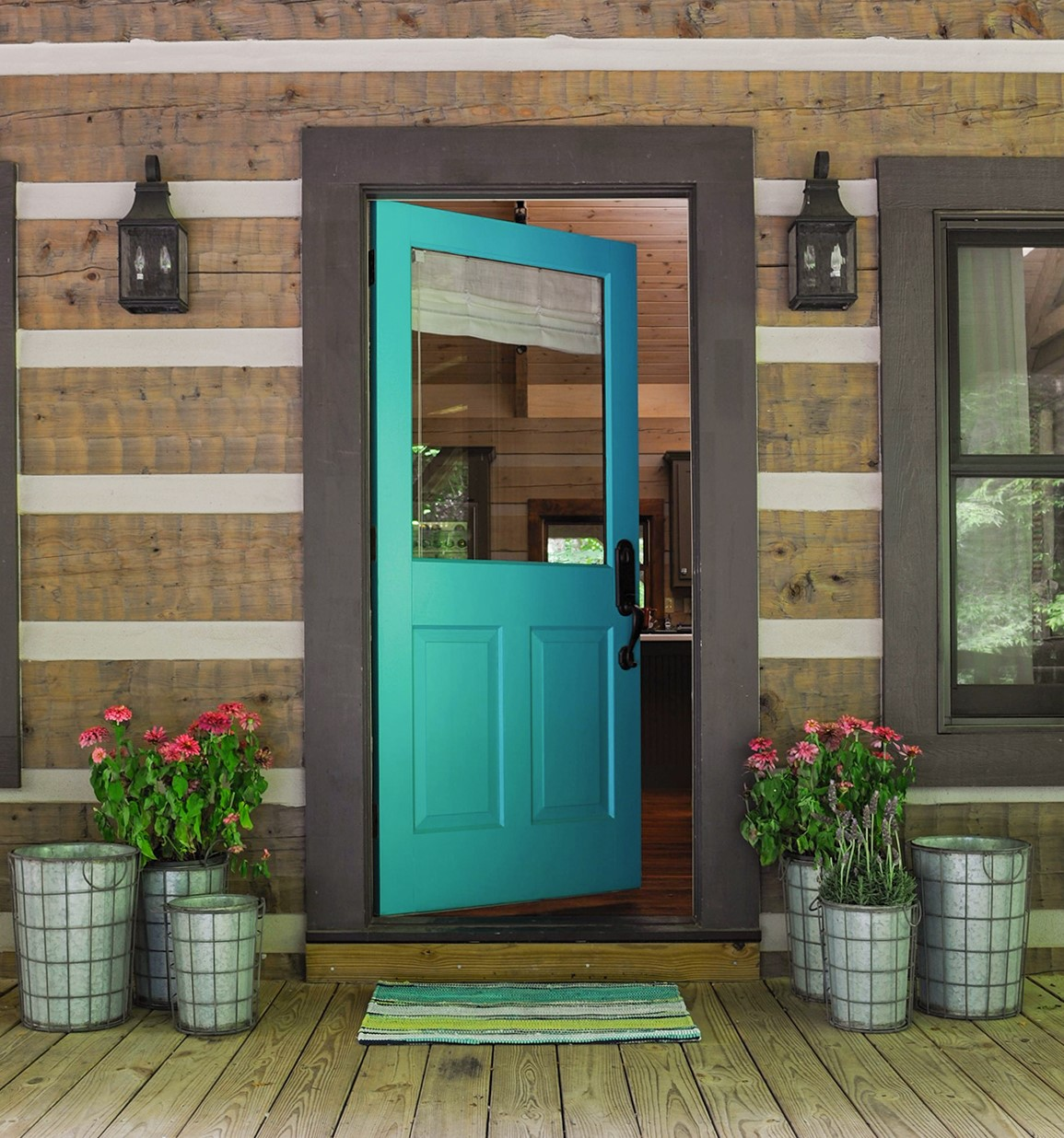 Bright teal-colored door on a log cabin