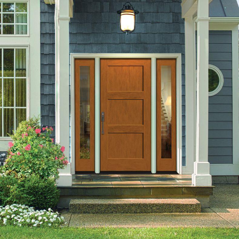Light woodgrain front door on a blue house