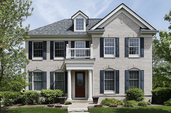 Traditional style home with shutters and double-hung windows