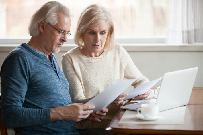 Older couple planning their home energy assessment