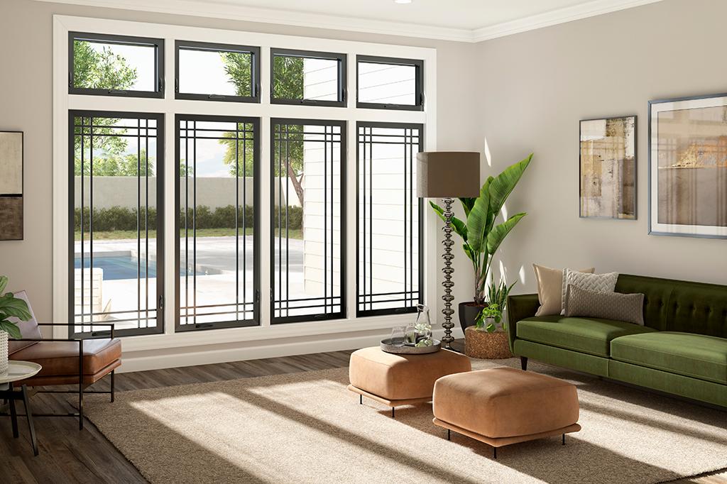 Trendy black-framed floor-to-ceiling windows in a sunny living room