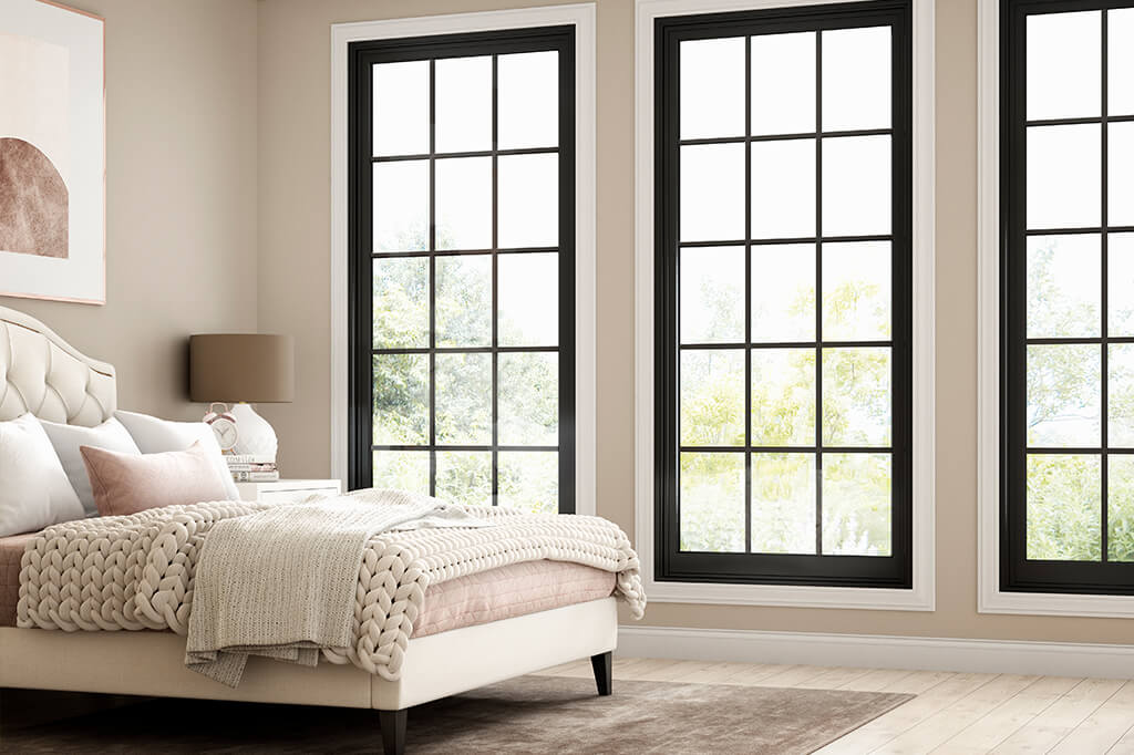 Black frame windows in a bedroom