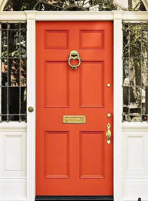 Orange front door with white trim