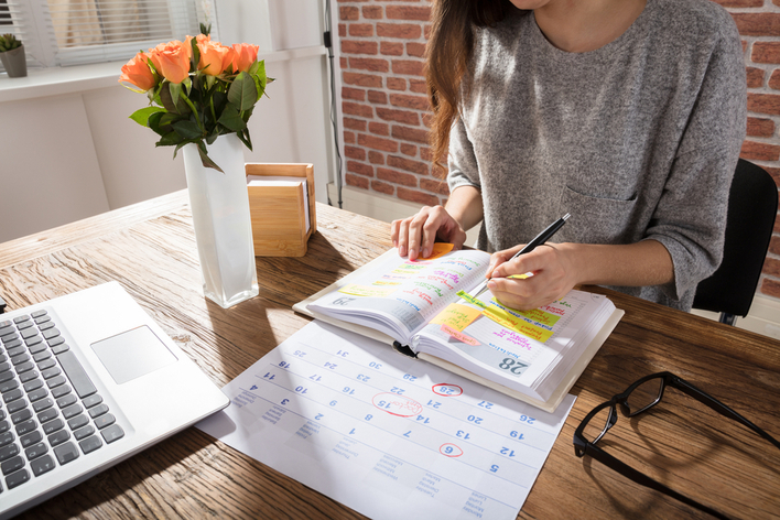 Woman adding tasks to her planner