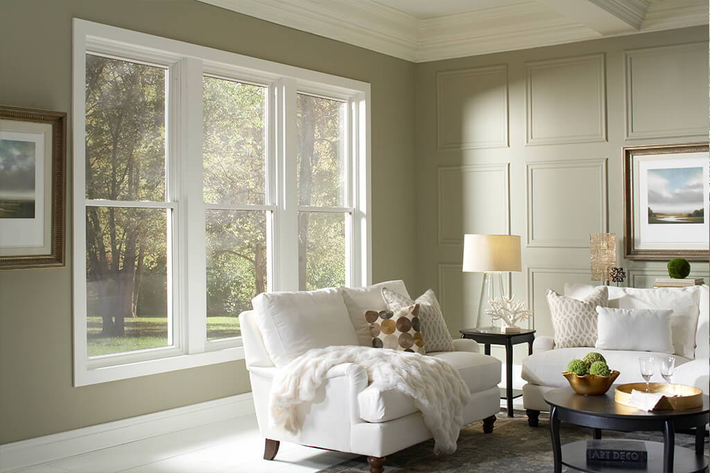 A living room with intricate molding details