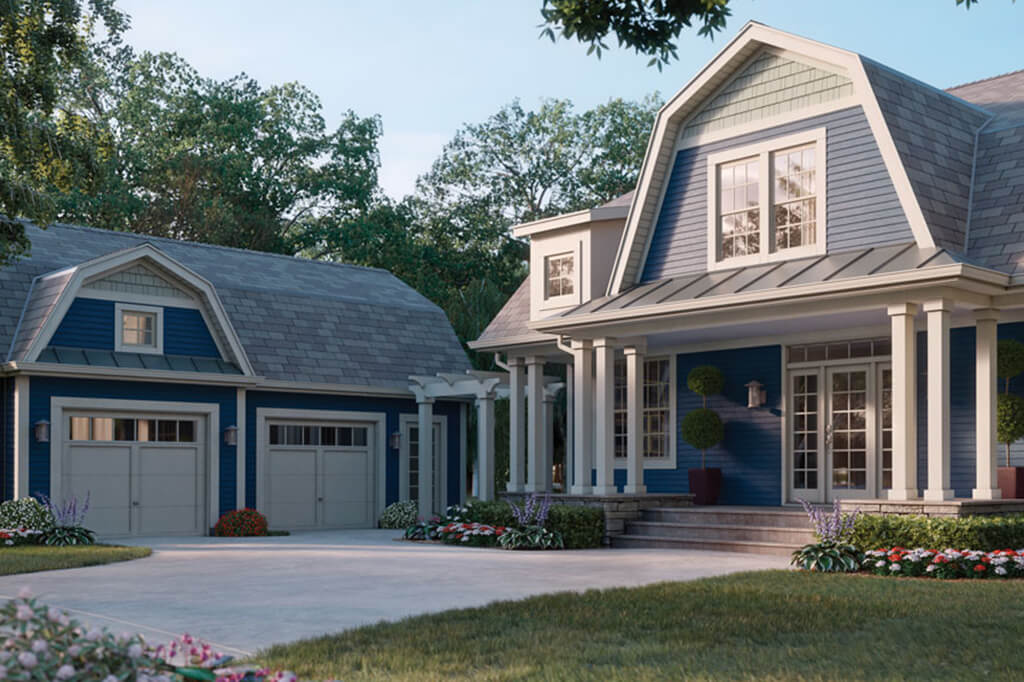 Beautiful house covered in blue vinyl siding