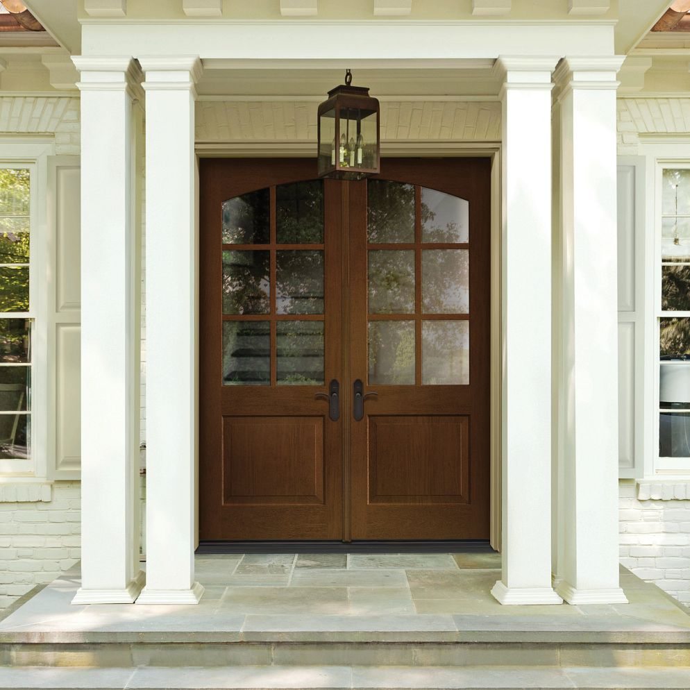 Wood-colored front door with white trim