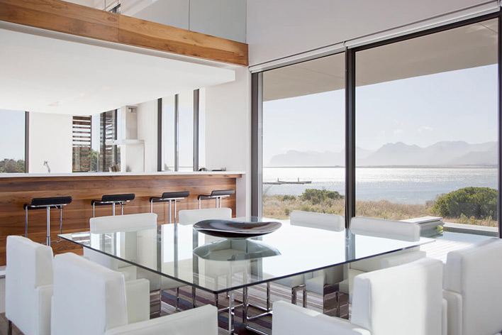 A room facing the sea with floor to ceiling windows