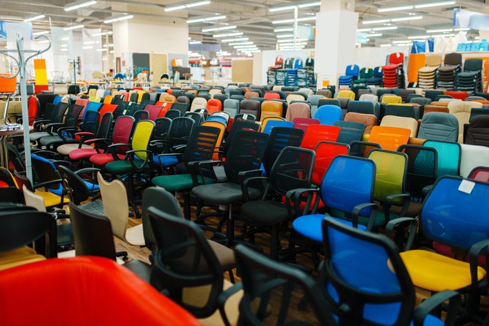 Many office desk chairs in various colors