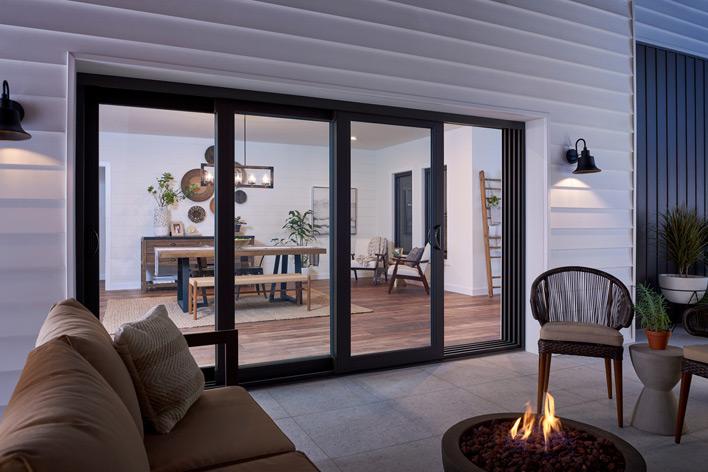 A multi-panel sliding patio door and outdoor patio