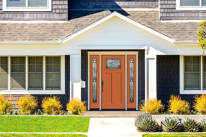 Orange front door on a house