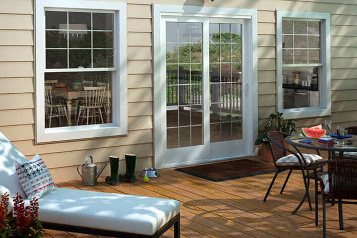 Back patio door leading to an outdoor living area