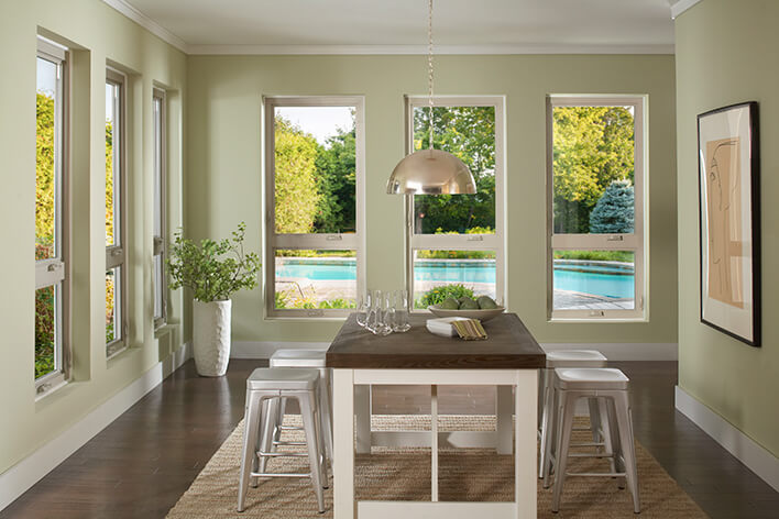 Dining room windows creating a focal point of the outside pool