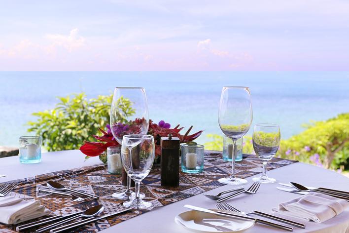 An outdoor table setting facing the ocean