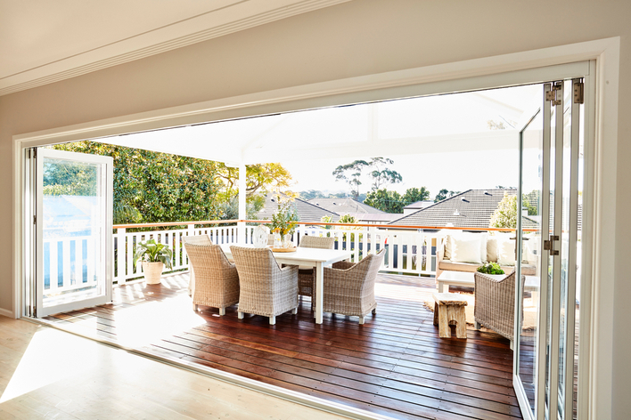 Folding patio doors looking out on a deck