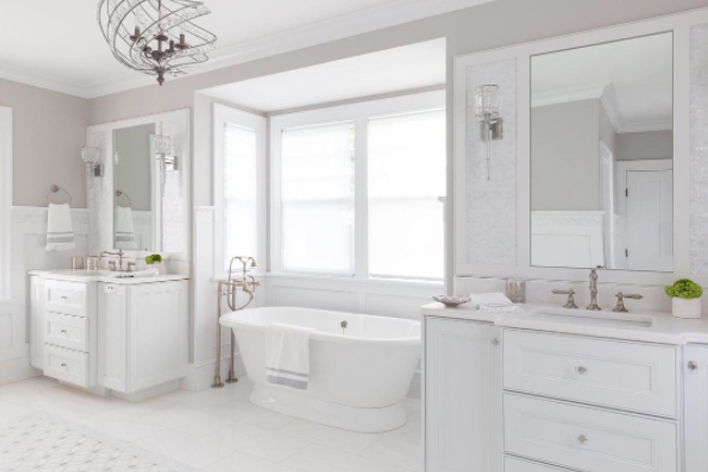 A clean white bathroom with elegant styling