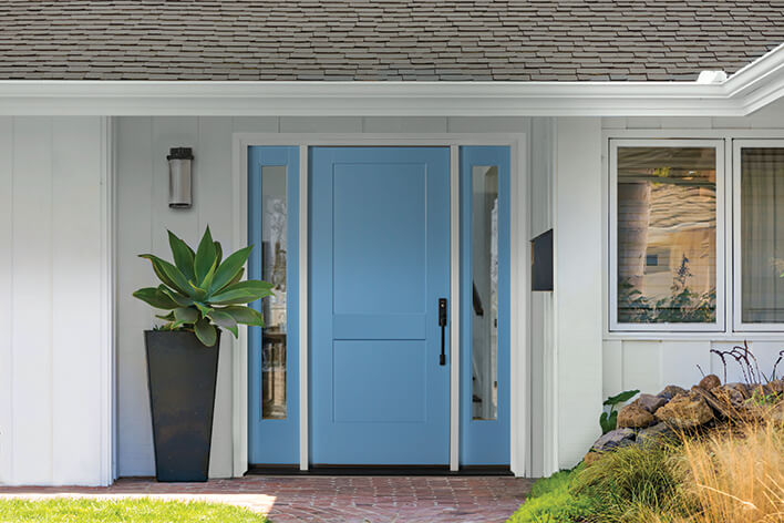 Blue front door with side windows