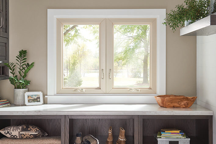 A laundry room with casement windows