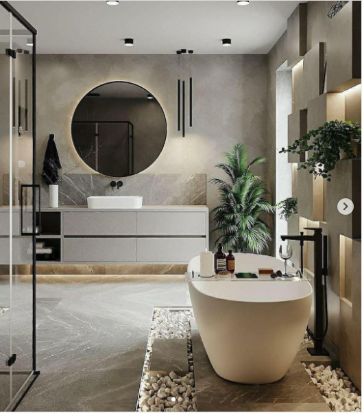 A modern bathroom with glass shower enclosure and large white tub