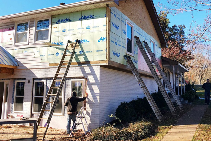 Vinyl siding being removed from a house