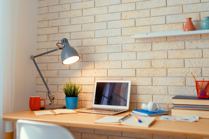An office desk with a charming lamp